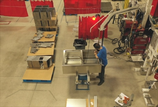 An Earnest Products worker, fabricating machine parts